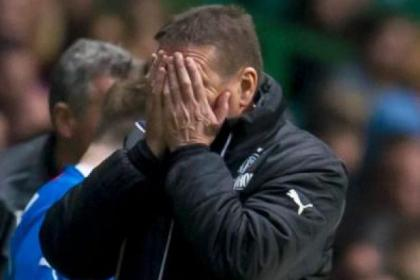 Kirkwood covers his face during last night's Old Firm encounter