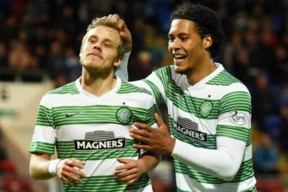 Virgil van Dijk congratulates Teemu Pukki after he put Celtic 2-1 ahead