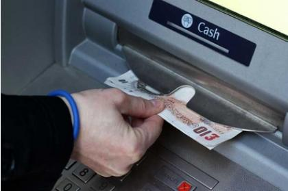 Suggest a machine to withdraw a fiver.