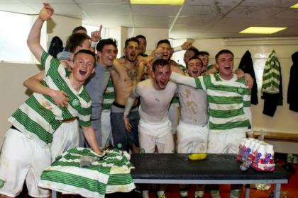 Liam Henderson leads the Celtic title celebrations in the Tannadice dressing room