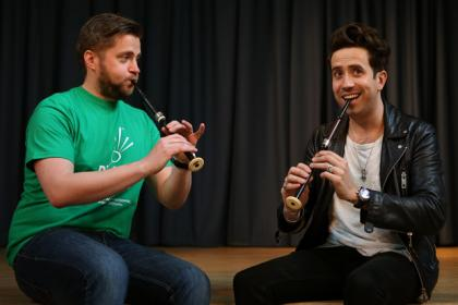 Radio 1 breakfast show host Nick Grimshaw is taught how to play the bagpipes at The National Piping Centre in Glasgow by Finlay MacDonald ahead of the Radio 1 Big weekend.