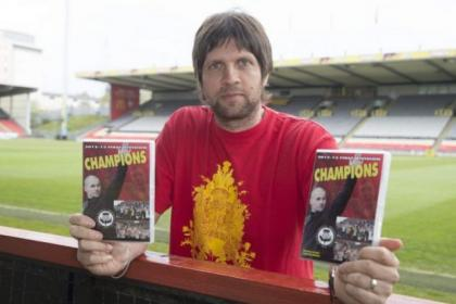 Scott Paterson with the club's DVD on winning last season's First Division