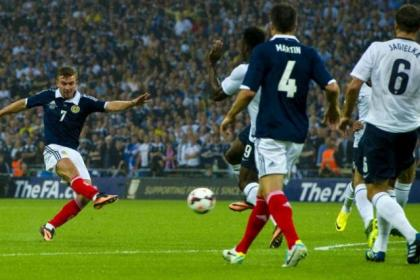 James Morrison opens the scoring for Scotland during their 3-2 defeat against England at Wembley last year