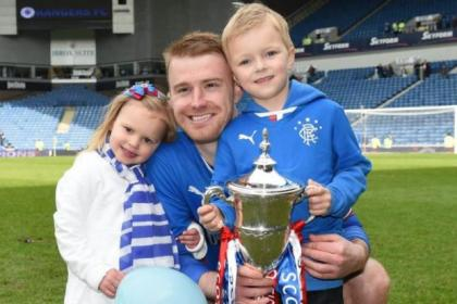 Stevie Smith and his children get to grips with the League One trophy