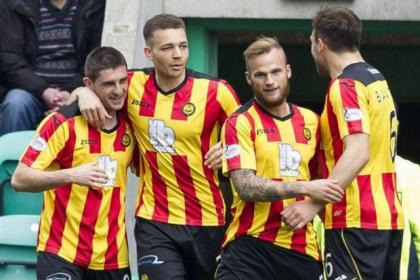 Mob handed...Kris Doolan, left is congratulated by his Thistle team-mates after his goal