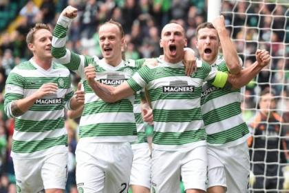 Scott Brown, second right, roars to the fans after scoring the second of his two goals (inset)