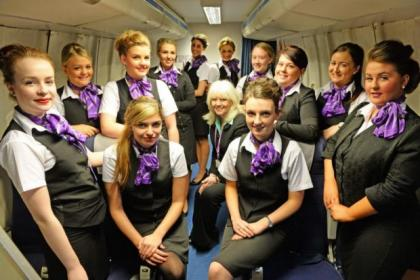 Jill Smith, left, and Hollie Lang practise serving a meal as part of their Air Cabin Crew Course at the City of Glasgow College