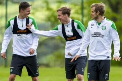 Stefan Johansen (centre) shares a joke with Mikael Lustig (left) and Teemu Pukki at Lennoxtown