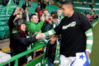 Emilio Izaguirre and his son, also Emilio, lap up the SPFL Premiership title win with the Celtic supporters before being given a break to prepare for the World Cup finals