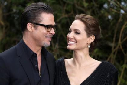 Brad Pitt and Angelina Jolie dazzle on the blue carpet