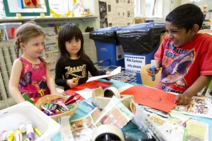 Whiteinch Nursery, above, received an outstanding report. Left: Caitlin Allan, Lucy Lin and Derekshan Onerious, all age 4, get creative at the Art Table. Below: Dougie McFarlane and Eva Hussain, both 4, pal about in the playground