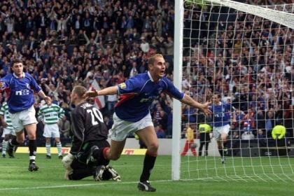 Rangers hero Peter Lovenkrands celebrates after scoring his last-gasp winner against Celtic in the Scottish Cup final in 2002. #SportTimestop50