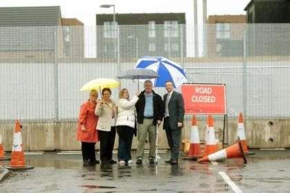 "John Mason has called for action to help the ""fenced-in"" residents"