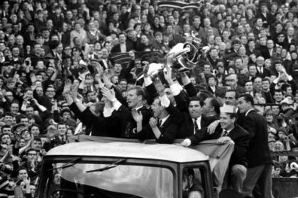 Bertie Auld, second from right in front row, parades the European Cup at Parkhead with his team-mates after Celtic's famous win over Inter Milan