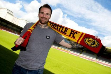 Ryan Stevenson is all smiles after signing a two-year deal with Partick Thistle