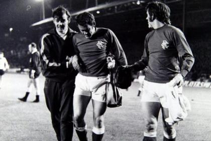 Former Rangers physio, Tam Craig, who died this week, is seen here attending to Andy Penman with skipper John Greig lending a helping hand