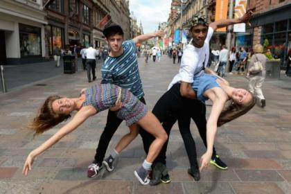 Fame cast members Alex Thomas, Sasi Strallen, Jodie Steele and Harry Blumenau dance their way down Glasgow's Buchanan Street