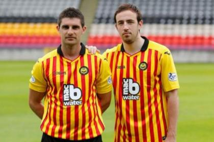 Kris Doolan and Stuart Bannigan model the new Partick Thistle home kit at Firhill. Picture: Martin Shields