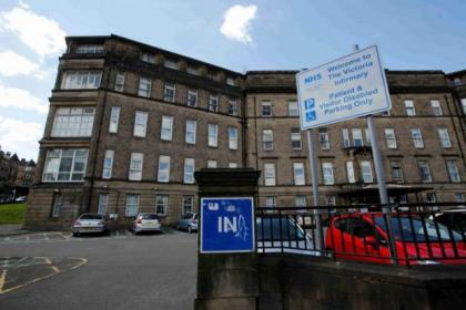 Staff at the Victoria Infirmary were criticised after patients' feet were left trailing while they were moved in wheelchairs