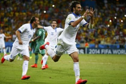 Georgios Samars celebrates after scoring the penalty that fired Greece into the last 16 of the World Cup Finals