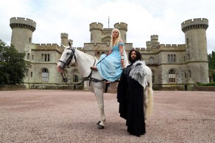 Game of Thrones superfans Kerry Ford and Darren Prew, who are dressed as Daenerys Targaryen and Jon Snow respectively, marry during their themed wedding at Eastnor Castle in Herefordshire, which was arranged by blinkbox.