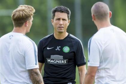 John Collins discusses tactics with Kris Commons and Scott Brown during a training session in Austria