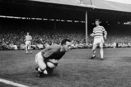 Celtic keeper Ronnie Simpson makes a save during a league match against Rangers at Ibrox in 1967
