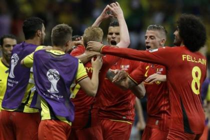 Kevin De Bruyne, centre, is surrounded by his team-mates after opening the scoring for Belgium against USA