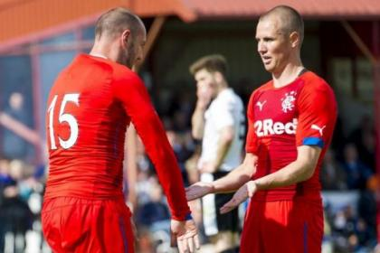 The old double act... Kris Boyd and Kenny Miller celebrate a return to the same team for Rangers in the Highlands