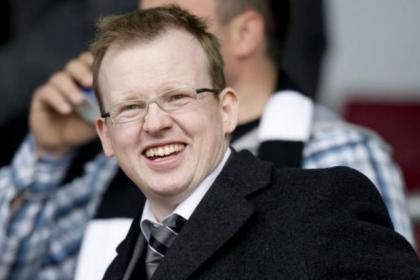 Richard Atkinson helped a supporters' group buy 70,000 shares in Rangers