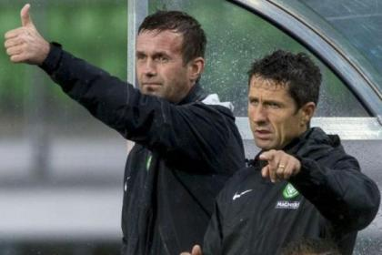 Ronny Deila and John Collins watch on in Austria