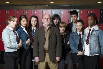 Gary Lewis, centre, plays Euan Girvan in the musical drama Glasgow Girls, co-starring, from left Ewelina (Effie Scott), Agnesa (Olivia Popica), Emma (Erin Armstrong), Toni-Lee (Kirsty Pickering), Jennifer (Kirstie Steele), Elvis (Vahid Gold), Roza (Aruhan Galieva), and Amal (Letitia Wright)