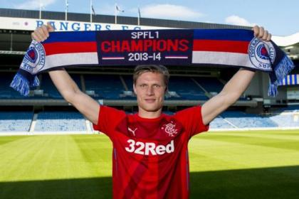 Scarf ace...Marius Zaliukas is delighted to be part of Rangers' journey back to the top flight of Scottish football