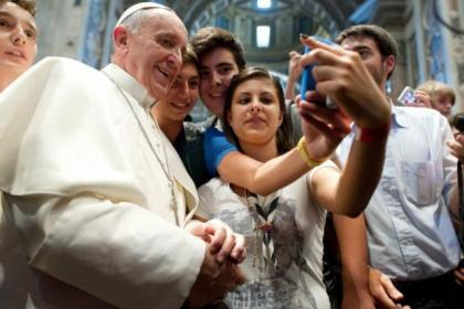 "Pope Francis was happy to feature in ""selfies"" for these young pilgrims to St Peter's Basilica in the Vatican City"