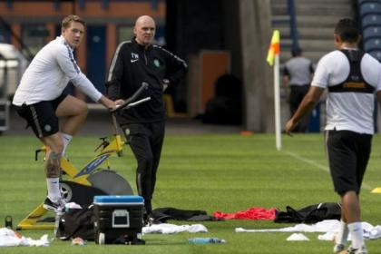 Pedal power ... under the watchful eye of physio Tim Williamson, Celtic striker Kris Commons worked out on a bike at Murrayfield