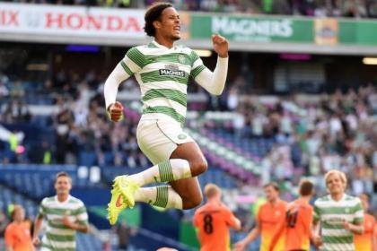 Virgil van Dijk leaps for joy after opening the scoring in Celtic's 4-0 win over KR Reykjavik