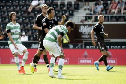Bahrudin Atajic hangs his head after his penalty miss as St Pauli players celebrate