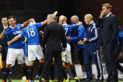Nicky Law (No.7) is mobbed by team-mates and management after scoring the winner for Rangers