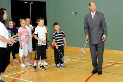 Prince Edward has a go at badminton with children from Renfrewshire Council's summer holiday activity scheme