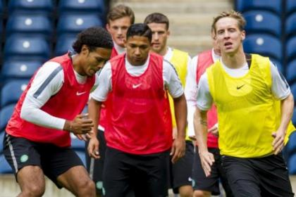 Stefan Johansen (right) with Virgil van Dijk and Emilio Izaguirre at a training session yesterday