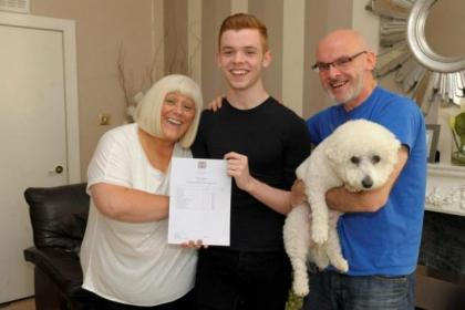 Marc Fingland, who achieved 5 'A' passes, with mum Sandra, dad James and dog Alfie Picture:  Kirsty Anderson