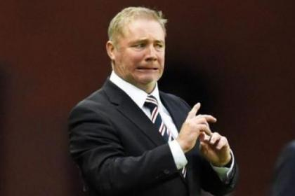 Girn and bear it . . . Ally McCoist does not look too happy with his Rangers stars during last night's cup tie against Hibernian