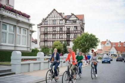 Cycling is an easy way to get around the coastal town of De Haan in Belgium