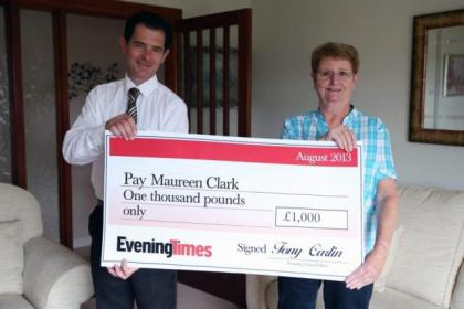 Evening Times home delivery executive Paul Keaney presents Maureen Clark with her cheque Picture: Colin Templeton