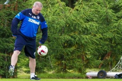 Rangers manager Ally McCoist shows his skills during a training session yesterday