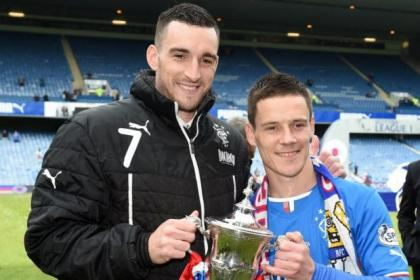 Second step ... Lee Wallace and Ian Black celebrate with the League One Trophy after beating Stranraer 3-0