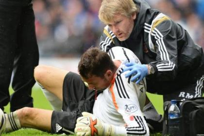Hearts keeper Neil Alexander was carried off with a suspected broken cheekbone after a clash with his own defender Alim Ozturk