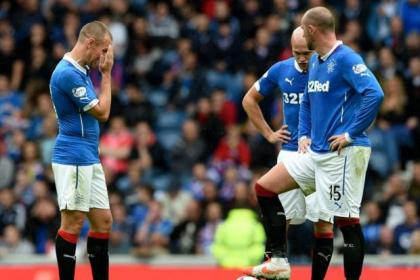 Dejection for Rangers trio, from left, Kenny Miller, Nicky Law and Kris Boyd after Hearts' late winner