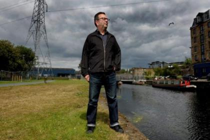 National Theatre of Scotland executive producer Neil Murray stands by the Forth and Clyde canal at Speirs Wharf. NTS has submitted a planning application to move to new premises by the canal next year. Picture: Kirsty Anderson