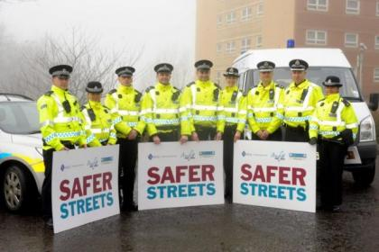 Police officers mark the start of the Maryhill 'Safer Streets' initiative in 2012   Picture: Kirsty Anderson
